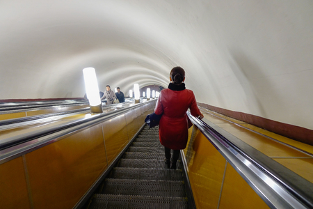 Moscow, Russia - Oct 16, 2016. A woman standing on escalator of subway station in Moscow, Russia. Moscow underground transit system is now more than 80 years old. Editorial