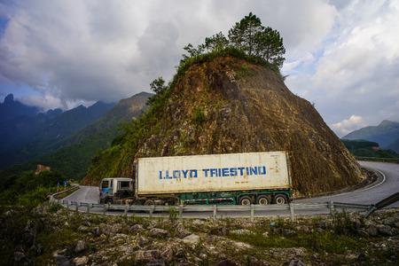 Ha Giang, Vietnam - Sep 28, 2016. A heavy truck running on dangerous road at summer day in Ha Giang, Vietnam.