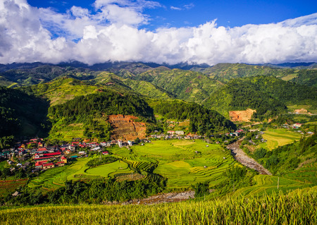 Small town with terraced rice field in Mu Cang Chai, Northern Vietnam. Stock Photo