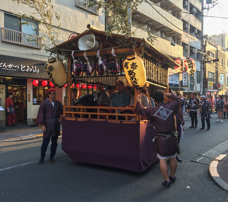 Tokyo, Japan - May 20, 2017. Procession of Mikoshi Matsuri Festival in Tokyo, Japan. A mikoshi is a divine palanquin (also translated as portable Shinto shrine). Editorial