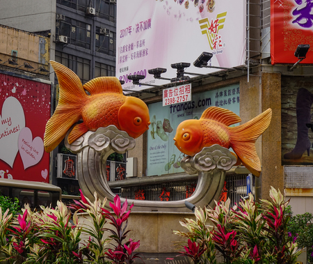 Hong Kong, China - Mar 29, 2017. Fish statues at gold fish market in Hong Kong, China. Gold fish market in Tung Choi street is famous for tourists. Editorial