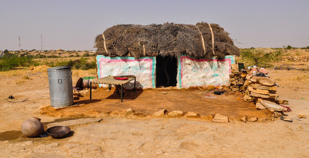 A poor house on desert in Jaisalmer, India. Jaisalmer, the Golden City, is located on the westernmost frontier of India.