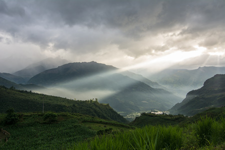 Mountains at sunset in Sapa, Vietnam. Sa Pa is a town in the Hoang Lien Son Mountains of northwestern Vietnam. Stock Photo