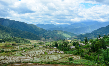 Terraced rice field with small village at summer in Lai Chau Province, Northern Vietnam.