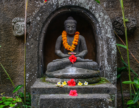 A Buddha statue at ancient temple in Bali, Indonesia.