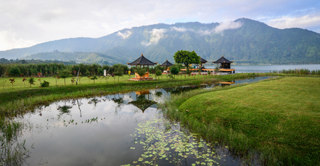 Part of Pura Ulun Danu temple with the park at the edge of Lake Bratan in Bali, Indonesia.