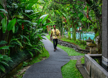 Bali, Indonesia - Apr 20, 2016. A man working at resort in Bali, Indonesia. Bali is a popular tourist destination which has seen a significant rise since the 1980s.