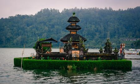 Pura Ulun Danu Beratan (Temple of Water) on Lake Bratan with forest background in Bali, Indonesia.