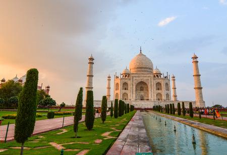 Agra, India - Jul 13, 2015. People visit Taj Mahal at sunset in Agra, India. The Taj Mahal attracts 7-8 million visitors a year.
