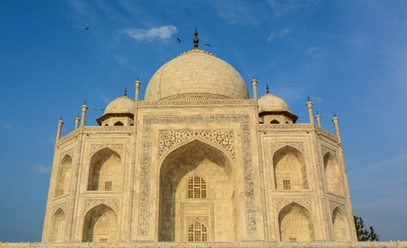 Marble hall of Taj Mahal under blue sky at sunny day in Agra, India. Editorial