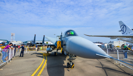 Singapore  - Feb 10, 2018. A Saab JAS 39 Gripen fighter aircraft belong to the Singapore Air Force on display at the 2018 Singapore Airshow.