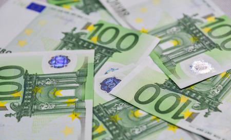 Close-up of 100 Euro bills (banknotes) money. European Union Currency. 스톡 콘텐츠