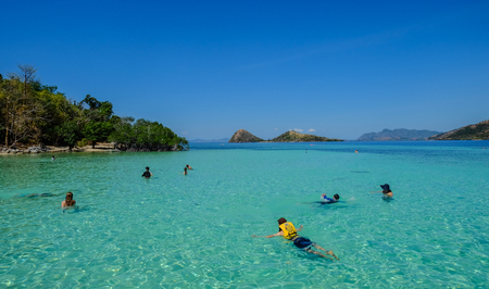 Coron, Philippines - Apr 10, 2017. People enjoy on sea in Coron Island, Philippines. Coron is a wedge-shaped limestone island in the province of Palawan. Editorial