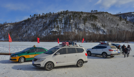 Mohe, China - Feb 19, 2017. Car parking lot of a winter park in Mohe County, Heilongjiang Province, China.