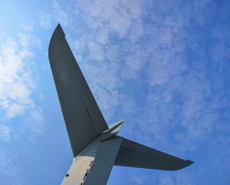 Tail of an aircraft against blue sky in Changi, Singapore. Stock Photo