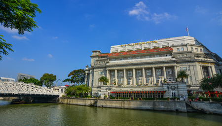Singapore - Feb 9, 2018. Famous Fullerton Hotel with riverscene in Singapore. Singapore is global financial center with a tropical climate and multicultural population. Editorial
