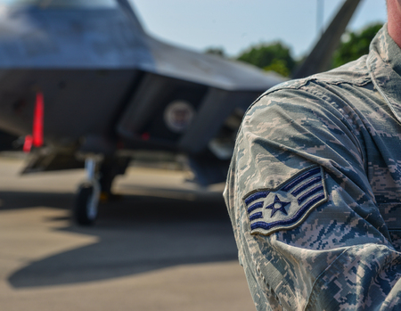 US Air Force Sign on the uniform of a soldier, with aircraft background. Stock Photo