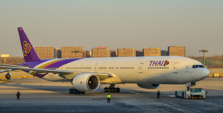 Beijing, China - Mar 1, 2018. A Thai aircraft running on runway at Terminal 3 of Beijing Capital Airport (PEK), China.