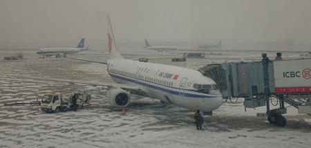 Harbin, China - Feb 28, 2018. An Air China aircraft in snowstorm at Harbin International Airport (HRB) in Heilongjiang Province, China.