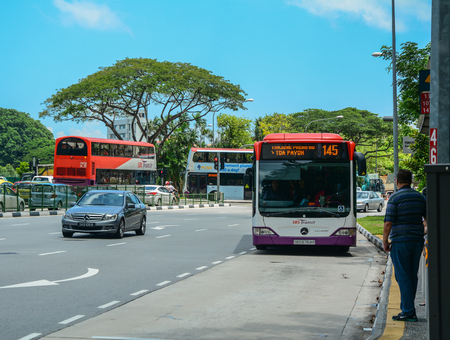 Singapore - Mar 12, 2016. Buses run on street in Singapore. Singapore economy has been ranked as the most open in the world. Editorial