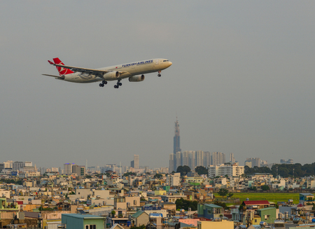 Saigon, Vietnam - Mar 11, 2018. An Airbus A330 aircarft of Turkish Airlines flying over the city in Saigon (Ho Chi Minh City), Vietnam.