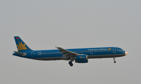 Saigon, Vietnam - Mar 11, 2018. An Airbus A321 aircarft of Vietnam Airlines is landing at Tan Son Nhat Airport (SGN) in Saigon (Ho Chi Minh City), Vietnam.