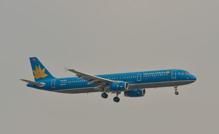 Saigon, Vietnam - Mar 11, 2018. An Airbus A321 aircarft of Vietnam Airlines is landing at Tan Son Nhat Airport (SGN) in Saigon (Ho Chi Minh City), Vietnam.