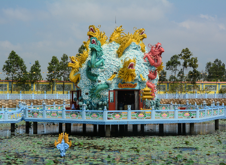 Mekong Delta, Vietnam - Mar 6, 2016. Dragon statues at Chinese temple in An Giang, Mekong Delta, Vietnam.