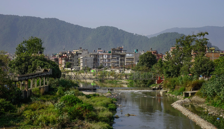 Kathmandu cityscape with a polluted river. Kathmandu is the largest metropolis in Nepal, with a population of 3 million.