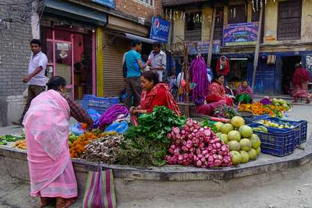 Kathmandu, Nepal - Oct 17, 2017. Vendors selling fruits and vegetables at street market in Kathmandu, Nepal. Editorial