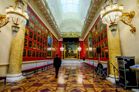 St. Petersburg, Russia - Oct 13, 2016. People visit a gallery at Hermitage Museum (Winter Palace) in St. Petersburg, Russia. Editorial