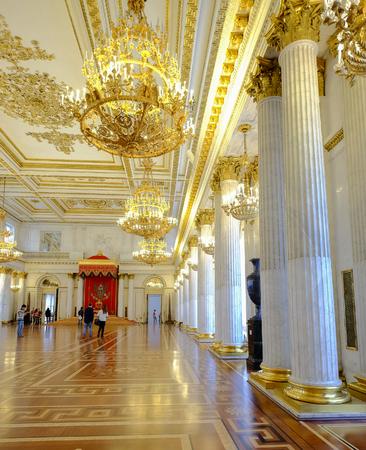 St. Petersburg, Russia - Oct 13, 2016. People visit Grand Throne room of Hermitage Museum (Winter Palace) in St. Petersburg, Russia.
