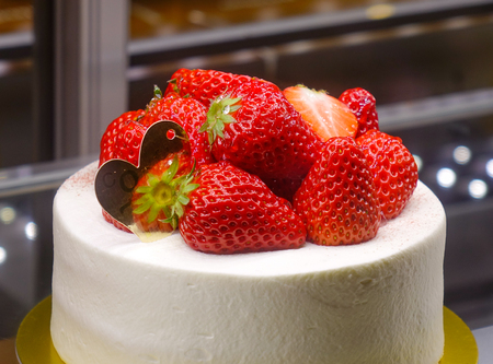 Sweet cake with fresh strawberry on top at the bakery.