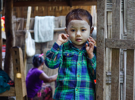 Mandalay, Myanmar - Feb 11, 2017. Portrait of Burmese boy at the village in Mandalay, Myanmar.