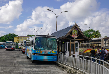 Port Louis, Mauritius - Jan 4, 2017. Local buses waiting at station in Port Louis, Mauritius. Port Louis is the country economic, cultural and political centre. Editorial