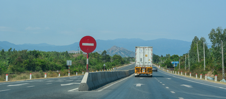 Nha Trang, Vietnam - Mar 21, 2016. A truck runs on National Route 1A in Nha Trang, Vietnam. The total length of the Viet Nam road system is about 222,179 km.