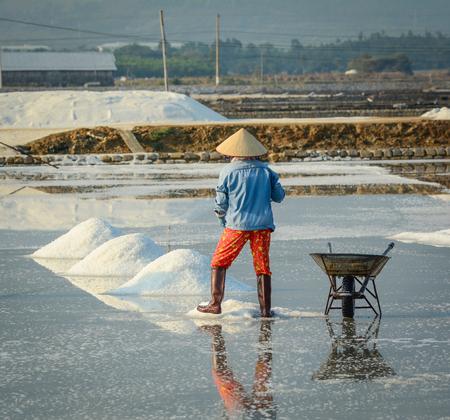 A farmer working on the salt field at Ninh Hoa Town in Khanh Hoa, Vietnam.
