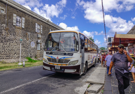 Port Louis, Mauritius - Jan 4, 2017. People waiting at bus station in Port Louis, Mauritius. Port Louis is the country economic, cultural and political centre.