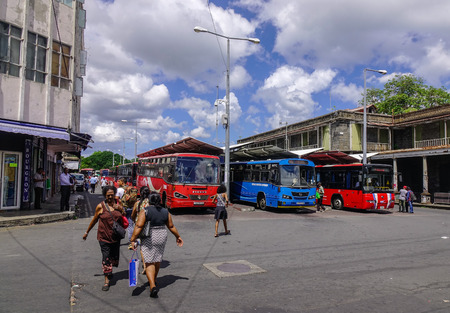 Port Louis, Mauritius - Jan 4, 2017. People walking at bus station in Port Louis, Mauritius. Port Louis is the country economic, cultural and political centre.