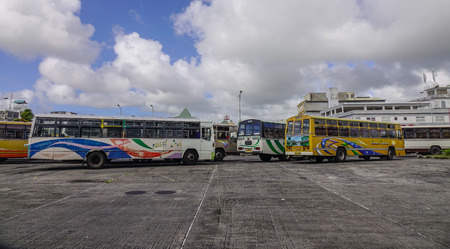 Port Louis, Mauritius - Jan 4, 2017. Local buses parking at station in Port Louis, Mauritius. Port Louis is the country economic, cultural and political centre.