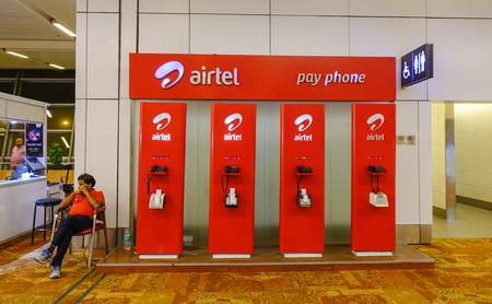 New Delhi, India - Nov 13, 2017. Telephone booth at Indira Gandhi Airport in New Delhi, India. The airport handled over 57.7 million passengers in fiscal year 2016-17. Editorial