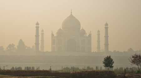 View of Taj Mahal at early morning fog in Agra, India. Stock Photo - 98842139