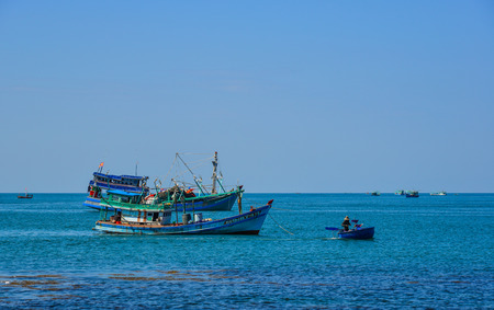 Kien Giang, Vietnam - Dec 6, 2017. Fishing boats on blue sea in Phu Quoc Island, Kien Giang, Vietnam. Editorial