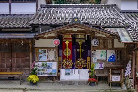 Kyoto, Japan - Nov 29, 2016. A gate of Shinto Shrine with tree forest in Kyoto, Japan. Standard-Bild - 98939221