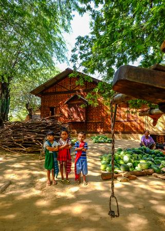 Bagan, Myanmar - Oct 19, 2015. Burmese children playing at small village in Bagan, Myanmar. Editorial