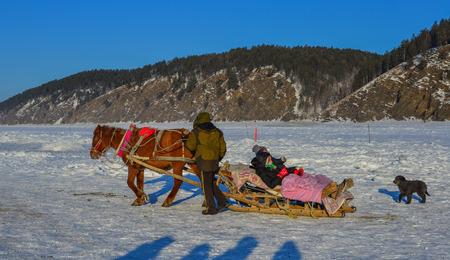 Heilongjiang, China - Feb 19, 2018. Horse cart running on snow river in Mohe County, Heilongjiang, China.