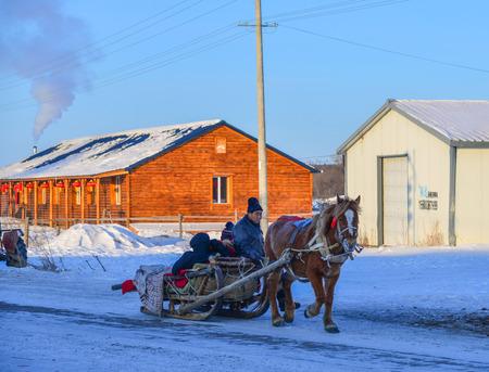 Heilongjiang, China - Feb 19, 2018. Horse cart running at snow village in Mohe County, Heilongjiang, China.