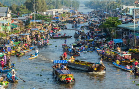 Mekong Delta, Vietnam - Feb 2, 2016. People with wooden boats at Nga Nam floating market in Mekong Delta, Vietnam. 報道画像