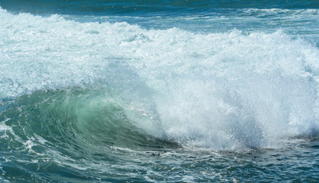 Huge waves on the blue sea in sunny day.