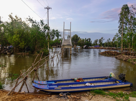 An Giang, Vietnam - Sep 2, 2017. River scenery with a bridge in An Giang, Vietnam. An Giang is a province in southern Vietnam, bordering Cambodia.